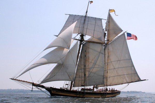 "The 157-ft Pride of Baltimore II is a reproduction of the Privateer Chasseur, a Baltimore-built topsail schooner that served as a blockade-runner and captured or sunk 35 British vessels. In 1815, The Niles Weekly Register dubbed her ""the Pride of Baltimore."" The British attacked Baltimore in 1814 in an attempt to destroy the Fells Point shipyards that built Chasseur and dozens of other privateers."