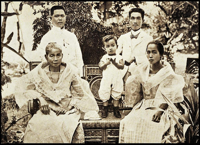 Emilio Aguinaldo (standing, right) with his sister (sitting right), son, mother, and brother