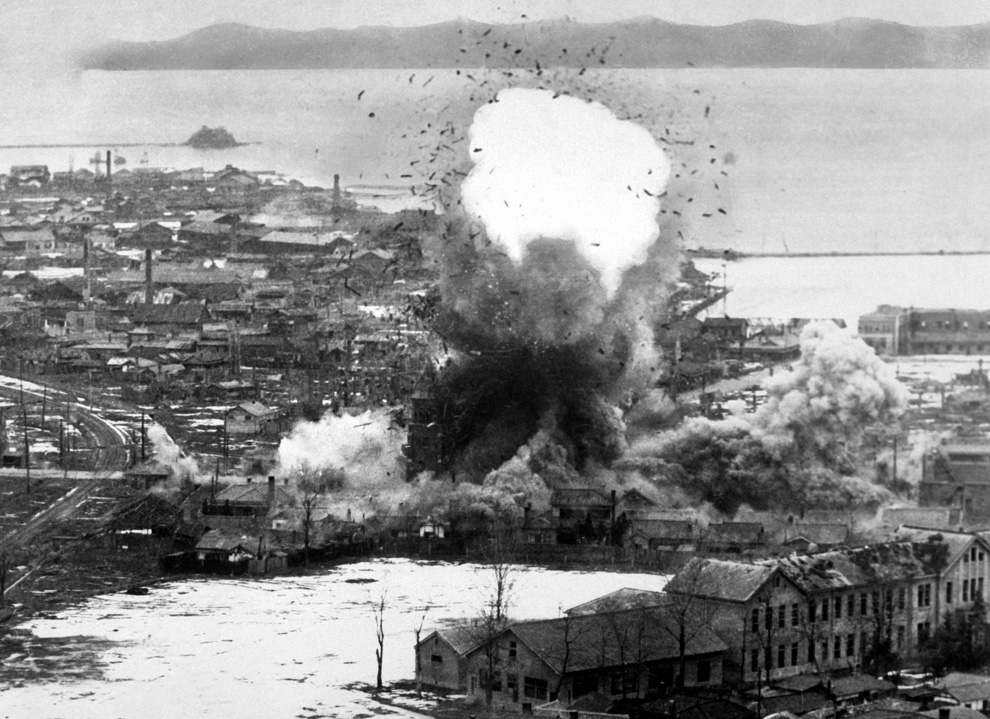 US Air Force bombers destroy warehouses and dock facilities in Wonsan, North Korea, 1951 (US Dept of Defense-USIA)