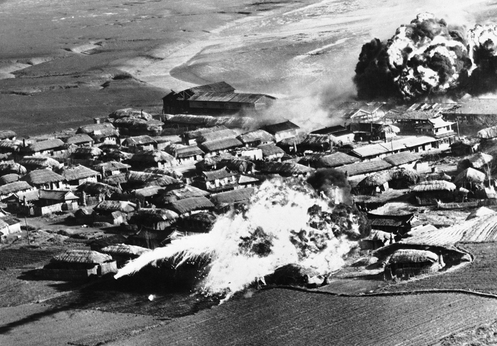 Thatched huts go up in flames after B-26 bombers unload napalm bombs on a village near Hanchon, North Korea, on May 10, 1951 (AP photo)