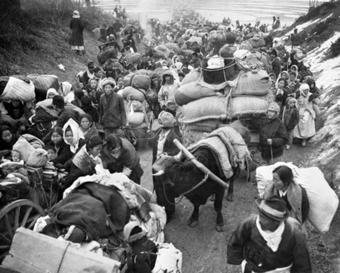 Battle-weary Korean civilians crowd a Korean road in late January 1951, seeking safety from the continuous fighting (UN Photo Archive).