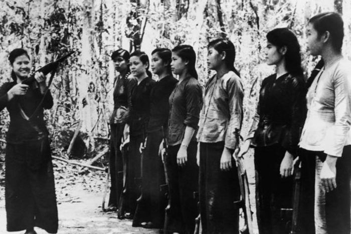 NLF fighter trains teenage girls in a jungle clearing, Sept. 8, 1867